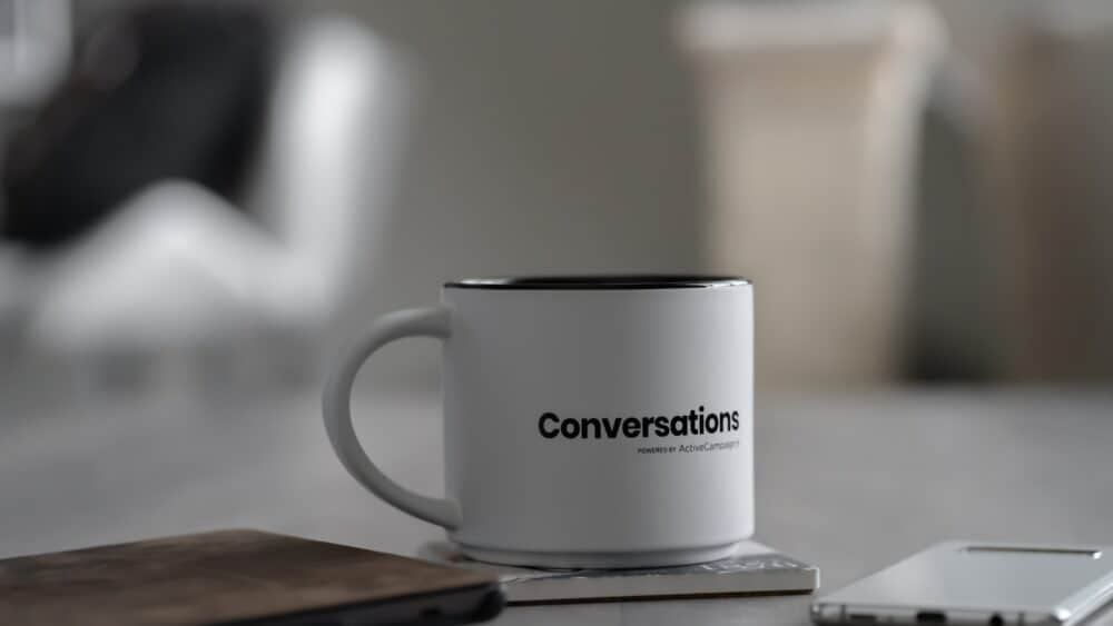 A coffee cup marked 'conversations'